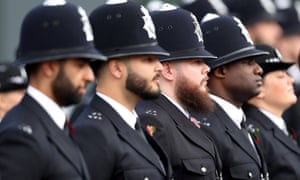 Graduating officers take part in the Metropolitan police's passing out parade for new recruits