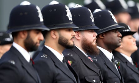 Officers attend a Metropolitan police passing out parade for new recruits
