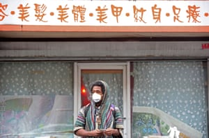 A man wears a mask in Chinatown in New York on 13 February.