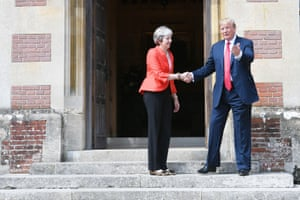 Theresa May greets Donald Trump on the doorstep as he arrives at Chequers