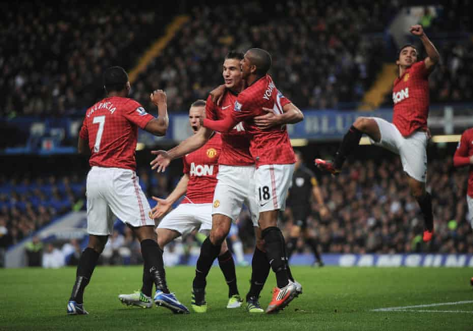 Van Persie with Ashley Young after scoring at Stamford Bridge in October 2012