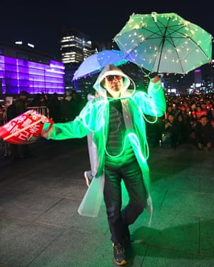 A man in an illuminated costume at a rally in Seoul demanding the arrest of Park Geun-hye.