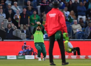 South Africa's JP Duminy takes a catch to dismiss Australia's Pat Cummins.