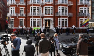 Members of the television media prepare to broadcast outside the Ecuadorian after British police arrested WikiLeaks founder Julian Assange.