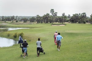 Young men from the local area work as caddies at the Mangais golf resort