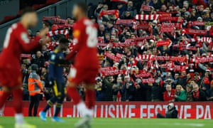 Liverpool fans cheer their team as kick-off approaches.