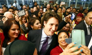 Justin Trudeau poses for selfies at Toronto Pearson international airport. One polling expert said of the prime minister's popularity: 'I've never seen anything like it.'