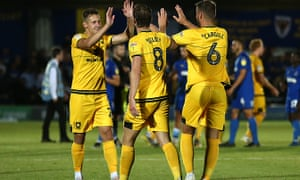 Alex Gilbey (centre) is congratulated after scoring the winning penalty