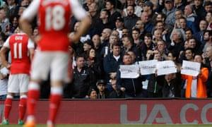 Spurs fans mocking Arsene Wenger during a Tottenham Hotspur v Arsenal match in 2017.