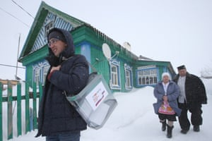 2018 Russian presidential electionTATARSTAN, RUSSIA - MARCH 18, 2018: An electoral official with a mobile ballot box during the 2018 Russian presidential election at a polling station in the village of Koshlauch. Yegor Aleyev/TASS (Photo by Yegor Aleyev\TASS via Getty Images)