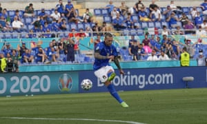 Italy's Federico Bernardeschi fires a shot which hits the post.
