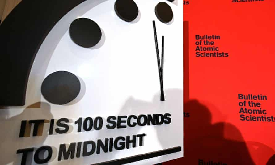 The Doomsday Clock reads 100 seconds to midnight, indicating the planet remains dangerously close to nuclear and climate change catastrophe.