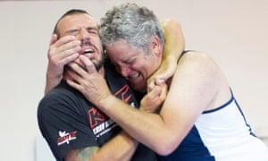 Stephen Moss, right, grapples with krav maga instructor Marcin Reszka.