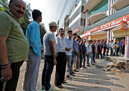 People queue outside bank in Lucknow, India