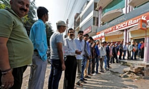 People queue to withdraw money at the ICICI bank cashpoint in Lucknow, India, on Monday.