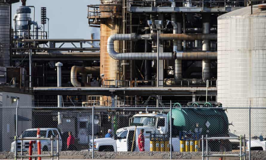 Workers stand in a lot at a LyondellBasell facility in La Porte, Texas.