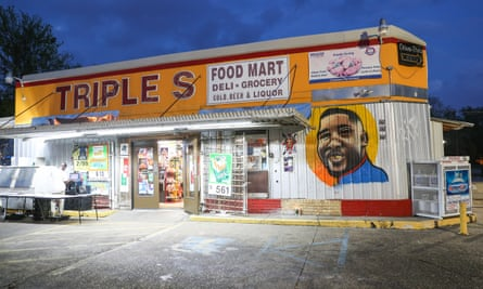A mural in memory of Alton Sterling outside the Triple S mart. Sterling was shot six times.