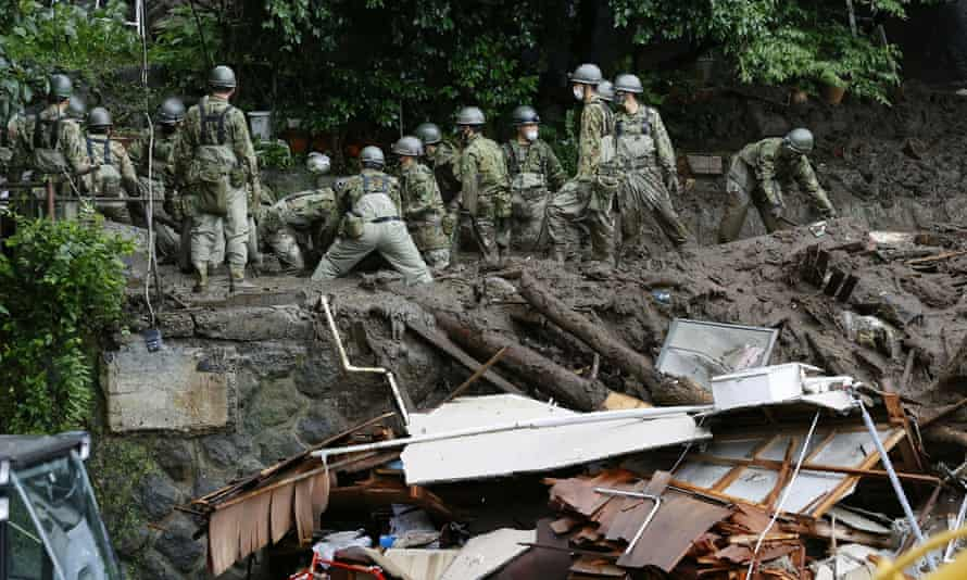 Aftermath of the Atami Landslide Members of the Japanese Self-Defense Forces conduct search and rescue operations at a landslide site caused by heavy rain in the Izusan district of Atami, west of Tokyo, Japan, on July 5. from 2021, in this photo taken by Kyodo.  Kyodo / via REUTERS ATTENTION EDITORS: THIS IMAGE WAS PROVIDED BY A THIRD PARTY.  MANDATORY CREDIT.  JAPAN OUT.  NO COMMERCIAL OR PUBLISHING SALES IN JAPAN