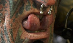 The NSW health minister has called for 'far more severe' controls over the body-modification industry.