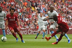 Mané shoots to score Liverpool's third.