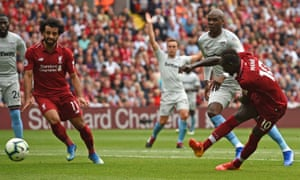 Sadio Mané, right, fires home Liverpool's third goal against West Ham United at Anfield.