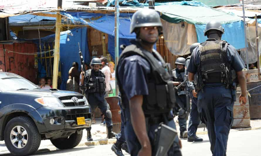 Police patrol in Kingston, Jamaica. Amnesty International research suggests unlawful killings by officers with state authorities' complicity.
