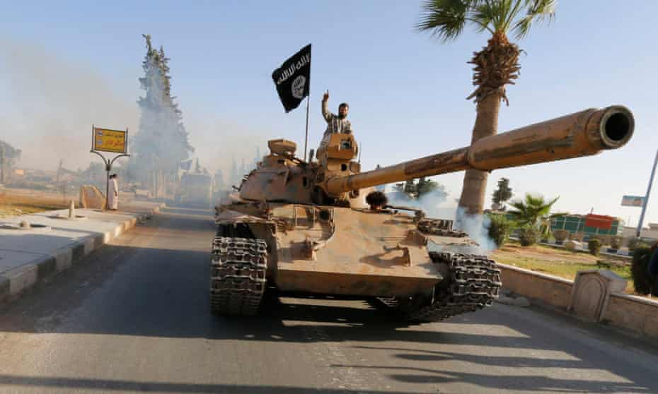 Militant Islamist fighters in a military parade in Syria's northern Raqqa province.