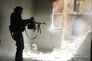 A Free Syrian Army member during a battle in the Sheikh Maksoud district