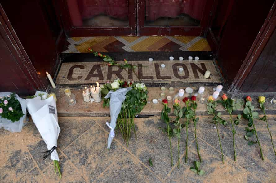 Flowers and candles are placed in tribute outside Le Carillon bar, the day after the deadly attacks.