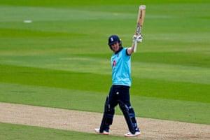 England's Eoin Morgan reacts to reaching his half century.