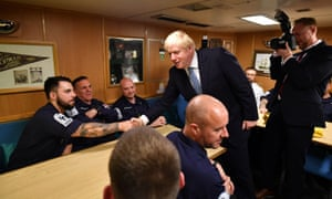 Boris Johnson meeting crew members in the mess hall of HMS Victorious at HM Naval Base Clyde in Faslane,