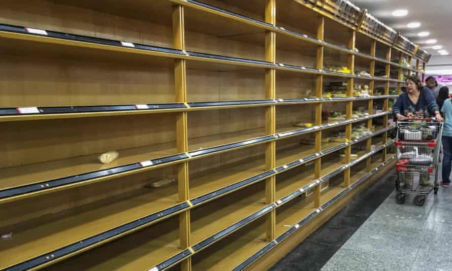 Empty Venezuelan supermarket shelves
