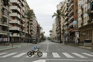 A boy rides a bicycle in Seville