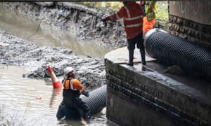 Flood defences are prepared in Mytholmroyd, in the Upper Calder Valley in West Yorkshire.