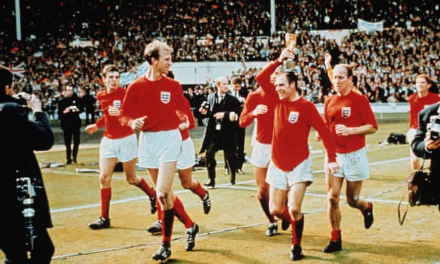 Ray Wilson, with the trophy, performing a lap of honour with the England team at Wembley after winning the World Cup final, 30 July 1966.