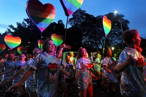 Parade goers dance along Oxford Street