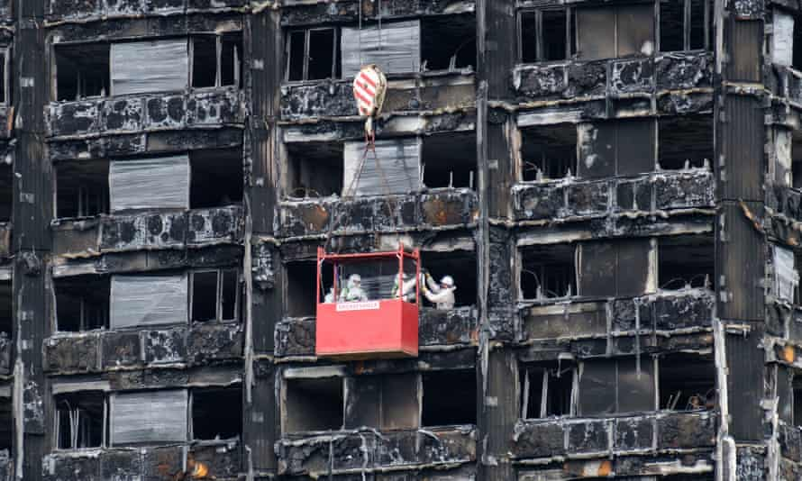 Work begins on covering Grenfell Tower with protective wrapping.
