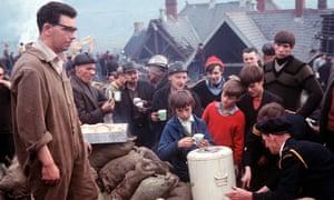 Rescuers queue for tea.
