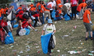 Litter pickers begin the job of clearing the fields at the Glastonbury festival