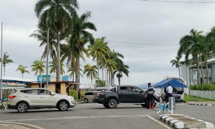 Police at a roadblock in the Fijian capital Suva. Recent allegations of police violence have sparked a nationwide debate over police use of force.