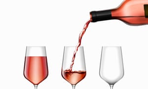 Rose wine being poured into three wine glasses