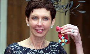 Denise Coates poses with her CBE medal.