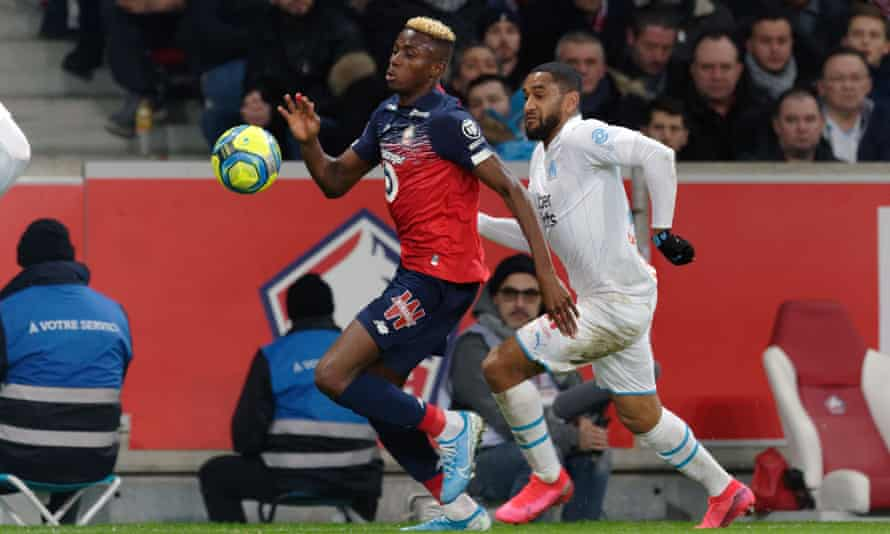Victor Osimhen (left) in action during the Ligue 1 match between Lille and Marseille in February.