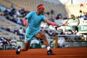 Rafael Nadal plays a backhand return.