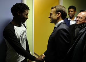 President Macron shakes hands with Ahmed Adam
