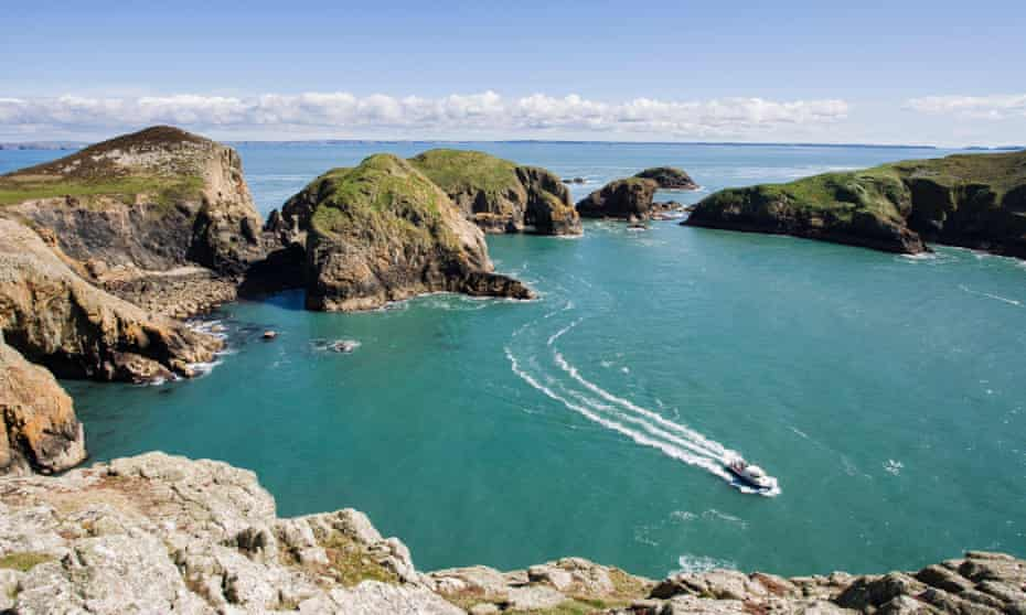 Boat in a bay of Ramsey Island, Pembrokeshire, Wales, United Kingdom.