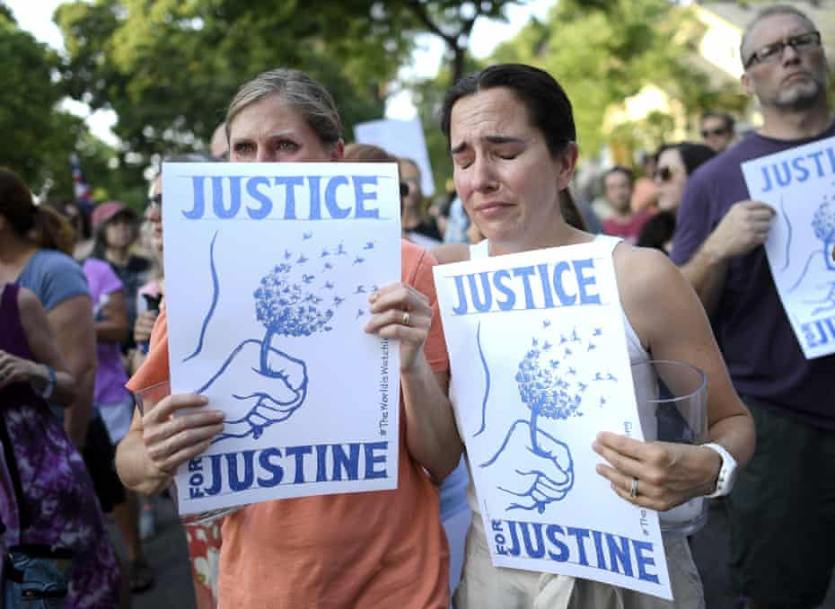 Protesters attend a march in honour of Justine Damond at Beard's Plaissance park on 20 July 20, 2017, in Minneapolis.