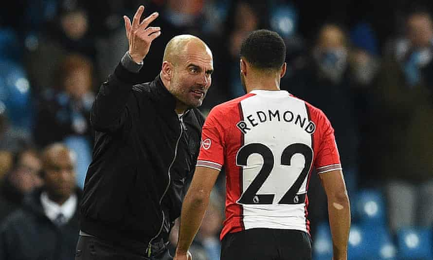 Pep Guardiola speaks to Nathan Redmond in animated fashion following Manchester City's 2-1 win against Southampton on Wednesday