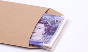 A stack of £20 notes inside a brown envelope