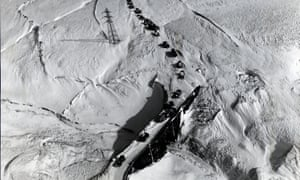 This aerial photograph of vehicles stranded by heavy snow on Woodhead Pass, between Manchester and Sheffield was taken by the Guardian's second staff photographer, Tom Stuttard in February 1958. It featured in the exhibition, 'A Long Exposure: 100 Years of Guardian Photography' at The Lowry, Manchester in 2008.